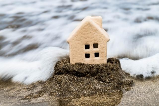 住宅と水害のイメージ